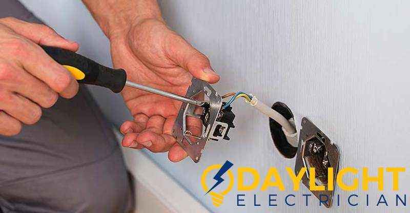 man-installing-socket-electrical-installationt-daylight-electrician-singapore