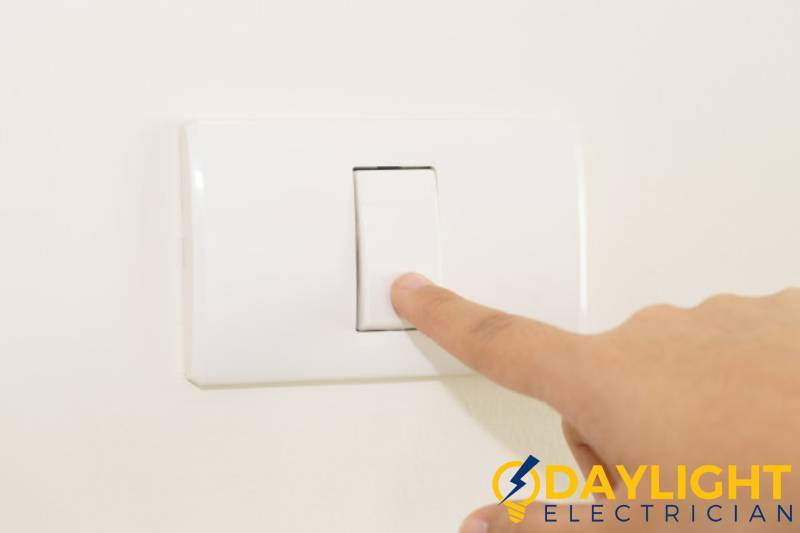 finger-on-switch-light-switch-problems-daylight-electrician-singapore