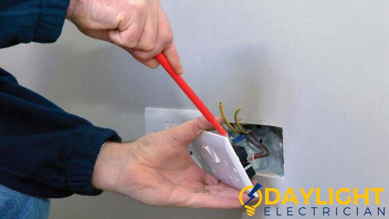 outlet-being-replaced-electrical-outlet-installation-daylight-electrician-singapore