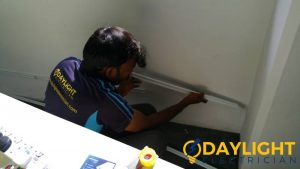 electrician-fixing-socket-electrical-services-everyworks-electrician-singapore
