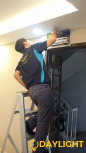 electrician-repairing-db-board-electrical-services-everyworks-electrician-singapore
