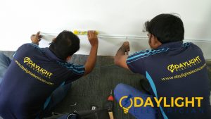 electricians-doing-repairs-electrical-services-daylight-electrician-singapore