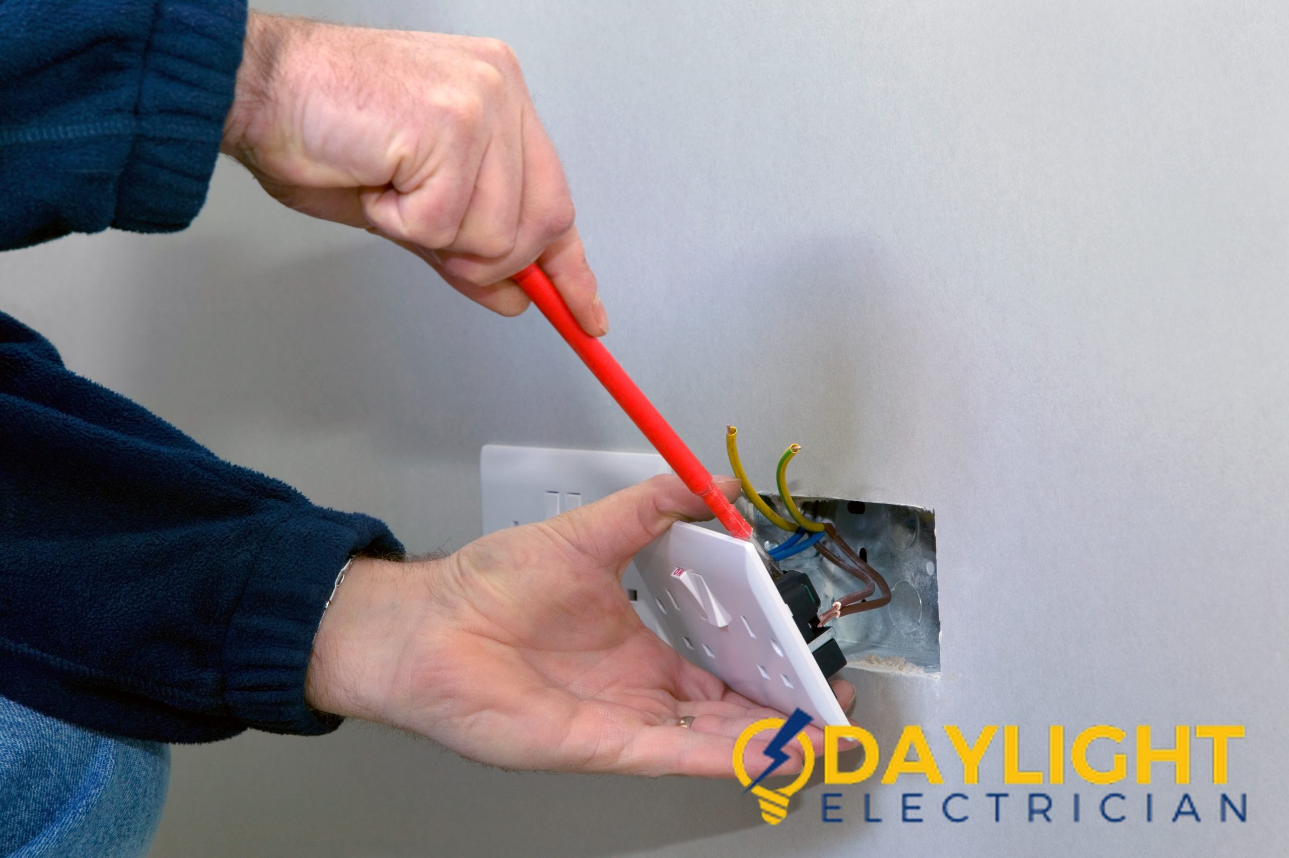 replace-power-socket-with-the-help-of-an-electrician-daylight-electrician-singapore_wm-scaled