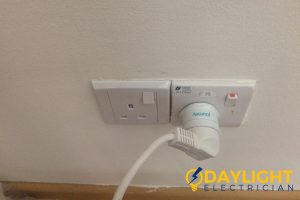 device-plugged-into-electrical-outlet-daylight-electrician-singapore
