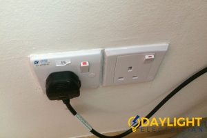 plugged-in-wire-power-socket-installation-daylight-electrician-singapore